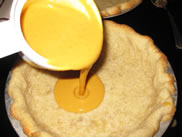 put pumpkin filling into pie crust