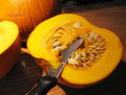 a fresh pumpkin cut in half